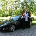 Sean Connery look-a-like beside Aston Martin